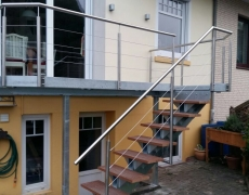 Balkon mit Mittelholmtreppe
